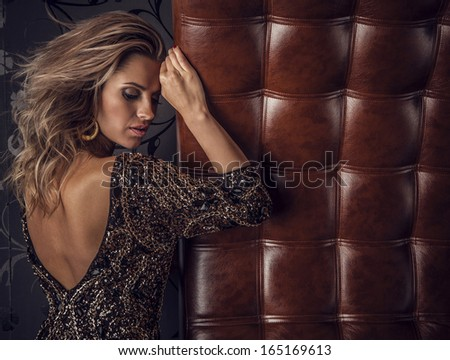 Young sensual & beauty woman posing on luxury leather sofa.  - stock photo
