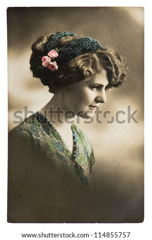 young sentimental woman with flowers. vintage picture ca. 1913 - stock photo