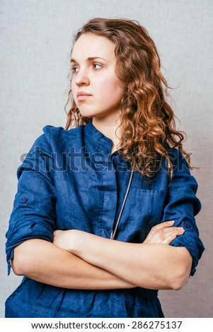 Young serious attractive woman - stock photo