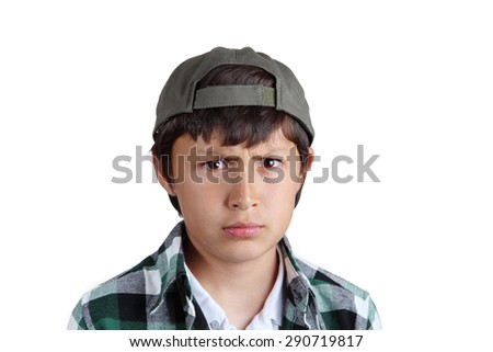 Young serious boy in green cap - stock photo