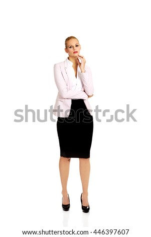 Young serious thoughtful business woman - stock photo