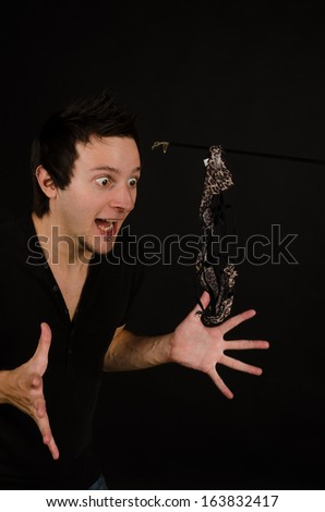 Young sex maniac lured towards some sexy knickers - stock photo