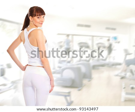 Young, sexy and sporty brunette in the gym - stock photo