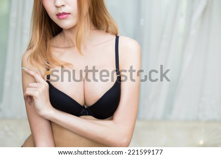 Young sexy asian woman in lingerie - stock photo