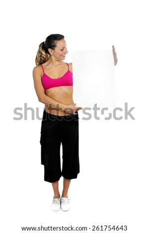 young sexy attractive woman in sport pants and pink bra holding blank billboard card with copy space in join the gym and fitness club concept isolated on white background - stock photo