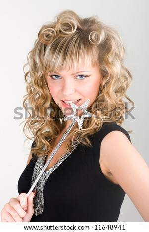 Young sexy blond fairy girl making her wish - stock photo