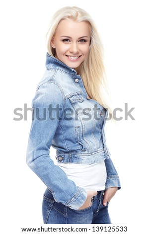 Young sexy blond woman in jeans jacket isolated on white - stock photo