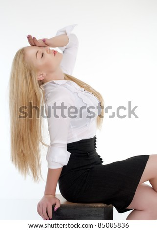 Young sexy blond woman in white shirt posing over white background.It is not isolated - stock photo