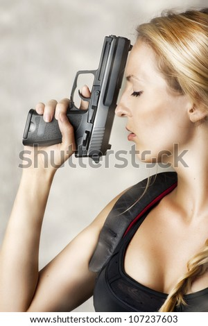 Young sexy blond Woman With Handgun - stock photo