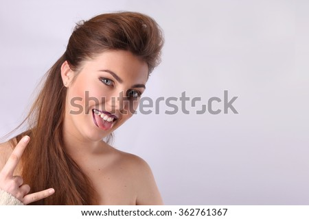 Young sexy brunette girl with long hair, the hair is braided with red lips - stock photo