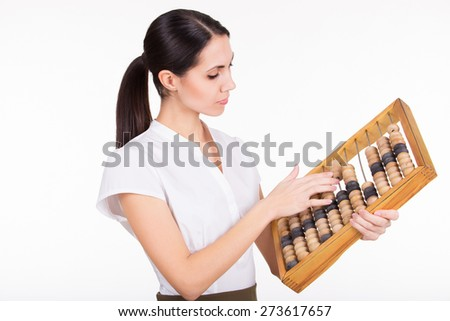 Young sexy business woman calculating finance with abacus - stock photo