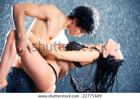 Young sexy couple. Water studio photo. - stock photo
