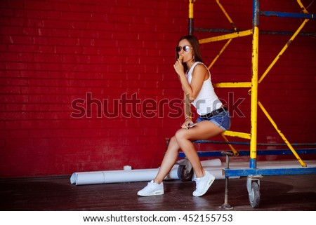 Young sexy girl eating ice cream in summer hot weather. Have fun and good mood - stock photo
