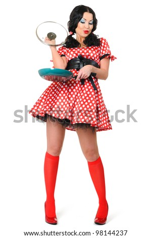Young sexy girl in a polka dot with frying pan on white background, pinup concept - stock photo