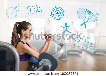 Young sexy girl in the gym trains hands - stock photo