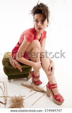 Young sexy girl model posing in fashion dress - stock photo