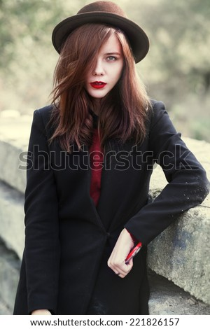Young sexy girl with red lips wearing a hat - stock photo