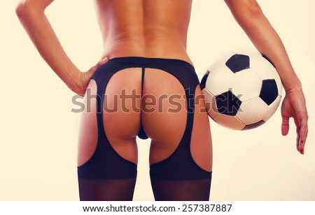 Young sexy girl with soccer ball - stock photo