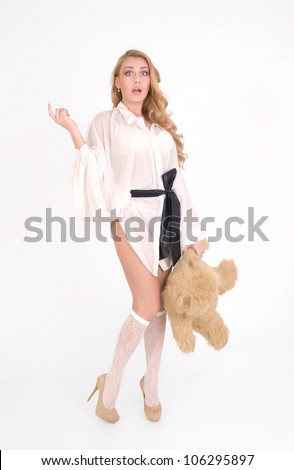 Young sexy girl with teddy bear is scared - stock photo