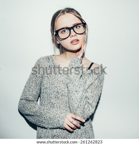 Young sexy happy woman looking at camera. Portrait of trendy girl having fun. Beautiful girl hipster.  Toned - stock photo