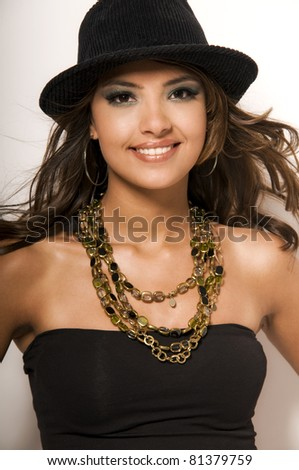 Young, sexy, indian woman on white background - stock photo