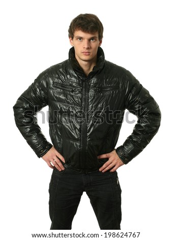 Young sexy man in winter clothes isolated on white - stock photo