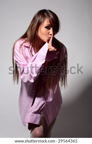 young sexy nude woman in men's pink shirt on gray - stock photo