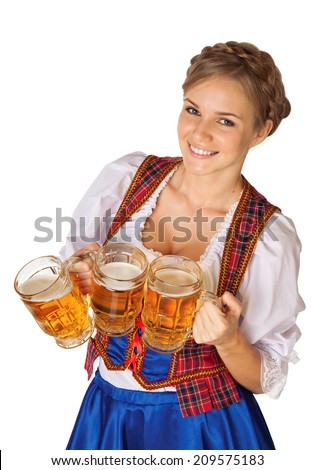 Young sexy Oktoberfest woman wearing a traditional Bavarian dress dirndl serving beer mugs - stock photo