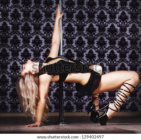 Young sexy pole dance woman - stock photo