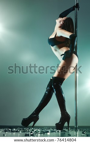 Young sexy pole dance woman. - stock photo