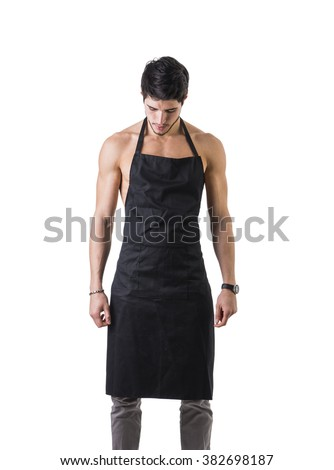 Young sexy shirtless chef or waiter wearing only apron - stock photo