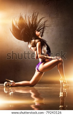 Young sexy woman dancing. With flash effect. - stock photo