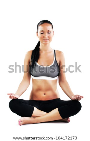 Young sexy woman doing yoga exercise - meditating - stock photo
