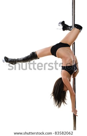 Young sexy woman exercise pole dance against a white background - stock photo