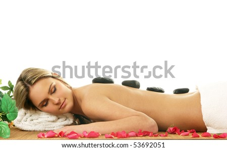Young sexy woman getting spa treatment isolated on white background - stock photo