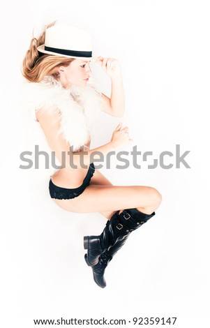 young sexy woman in boots, fur and hat, studio white - stock photo