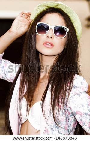 Young sexy woman in bright summer hat and sunglasses. Outdoors - stock photo