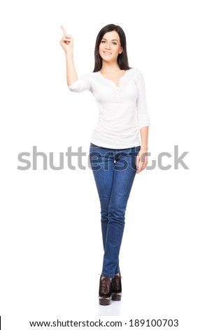 Young sexy woman in denim jeans isolated on white - stock photo