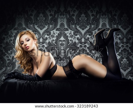 Young sexy woman in erotic lingerie - stock photo