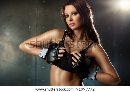 Young sexy woman in fighting gloves. - stock photo