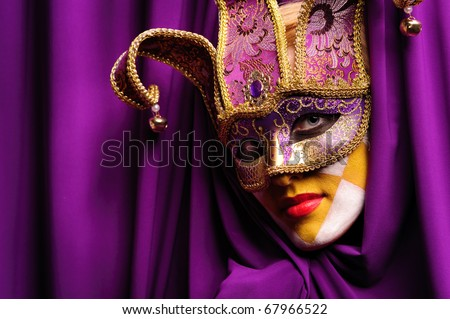 young sexy woman in violet mask open curtain - stock photo