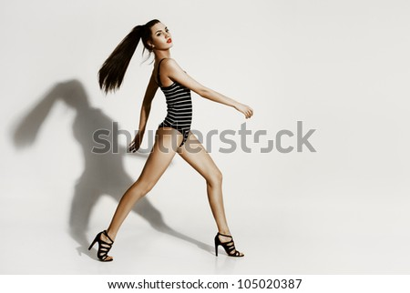 Young sexy woman on the white background - stock photo