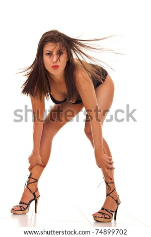 Young sexy woman posing with wild hair - stock photo