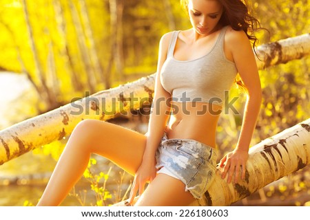 Young sexy woman sunny portrait. - stock photo
