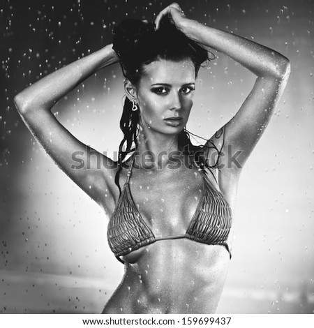 Young sexy woman water studio portrait. Black and white. - stock photo