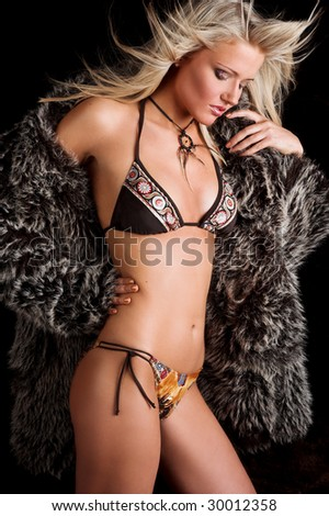 Young sexy woman wearing fur - stock photo