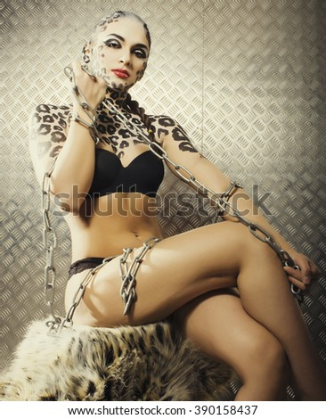 young sexy woman with leopard make up all over body, cat bodyart closeup sensual - stock photo