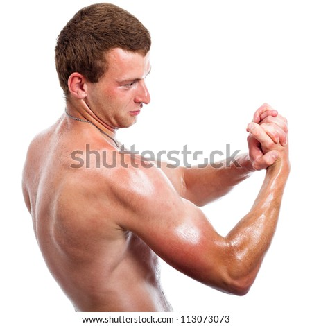 Young shirtless sports man posing, showing biceps, isolated on white background. - stock photo