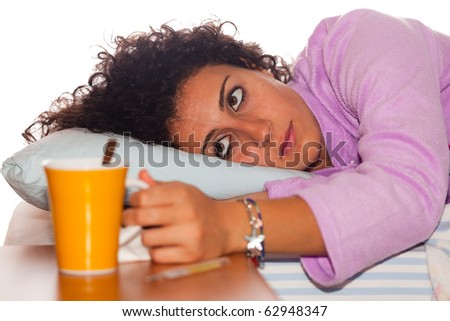 Young Sick Woman Lie on the Bed - stock photo