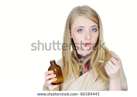 Young sick woman taking syrup - stock photo